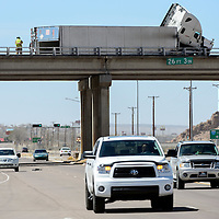040114       Adron Gardner/Independent<br /> <br /> Eastbound Historic Highway 66 traffic passes under a tractor trailer leaning on the Interstate 40 overpass railing at exit 26 in Gallup Tuesday.