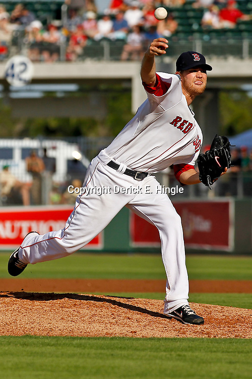 March 15, 2012; Fort Myers, FL, USA; Boston Red Sox relief pitcher Daniel Bard (51) throws during the top of the sixth inning of a spring training game against the St. Louis Cardinals at Jet Blue Park. Mandatory Credit: Derick E. Hingle-US PRESSWIRE