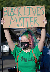 A woman holds a sign at a June 3, 2020, Black Lives Matter protest in Eugene, Oregon. Participants were protesting the murder of George Floyd and other African-Americans by police.