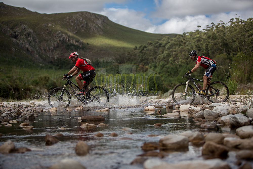 Riders make their way through the water crossings just outside Greyton during stage 4 of the 2014 Absa Cape Epic Mountain Bike stage race from The Oaks Estate in Greyton, South Africa on the 27 March 2014<br /> <br /> Photo by Karin Schermbrucker/Cape Epic/SPORTZPICS