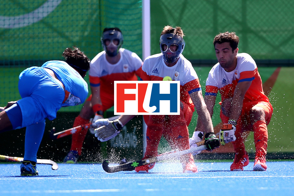 RIO DE JANEIRO, BRAZIL - AUGUST 11:  Sander de Wun #12 of Netherlands attempst to blocka a shot against India during a Men's Preliminary Pool B match on Day 6 of the Rio 2016 Olympics at the Olympic Hockey Centre on August 11, 2016 in Rio de Janeiro, Brazil.  (Photo by Sean M. Haffey/Getty Images)