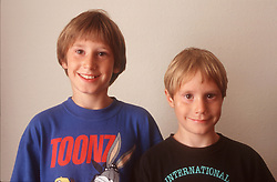 Portrait of two young boys smiling,