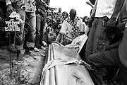 Relatives prepare to bury the body of Rachel Yaki Diane, 26, who died following a polio infection at the Vendelou cemetery in Pointe-Noire, Republic of Congo on Saturday December 4, 2010.