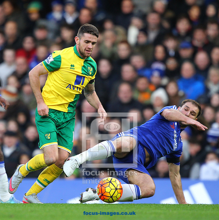 Robbie Brady of Norwich and Branislav Ivanović of Chelsea in action during the Barclays Premier League match at Stamford Bridge, London<br /> Picture by Paul Chesterton/Focus Images Ltd +44 7904 640267<br /> 21/11/2015