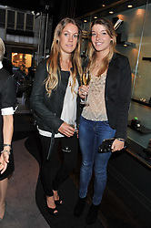 Left to right, the HON.EMILY PEARSON and EMERALD PEARSON at a private view of jewellery and photographs by Rosie Emerson and Annoushka Ducas entitled Alchemy in association with Ruinart Champagne held at Annoushka, 41 Cadogan gardens, London SW3 on 15th September 2011.