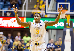West Virginia Mountaineers guard Juwan Staten (3) celebrates after making a three pointer against the Kansas Jayhawks during the second half at the WVU Coliseum.