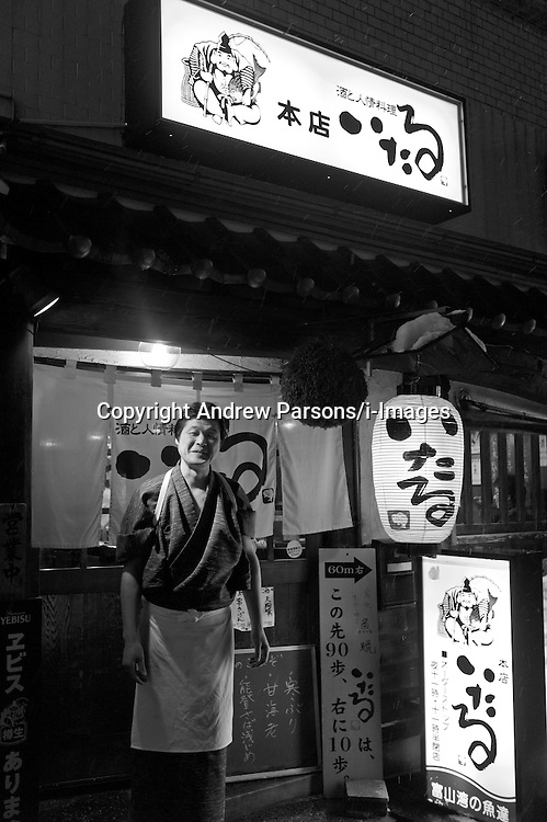 A sushi Chef stands outside his izakaya pub Restaurant in Kanazawa, Japan, February, 2012. Photo By Andrew Parsons/ i-Images