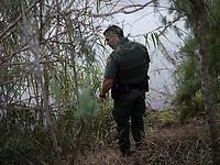 A border patrol agent looks for tracks along the Rio Grande river, in Hidalgo, TX, on the U.S.-Mexico border, on February 2, 2017 (Photo/Scott Dalton)