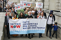 © Licensed to London News Pictures. 26/06/2019. London, UK. Walk of witness, from Trafalgar Square via the Palace of Westminster to Church house, led by former Arch Bishop of Canterbury Rowan Williams and other faith leaders ahead of the Time is Now mass lobby for climate change. Photo credit: Joe Newman/LNP