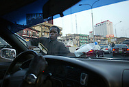streetchildren earn some little moneu by cleaning windows at traffic jams.
