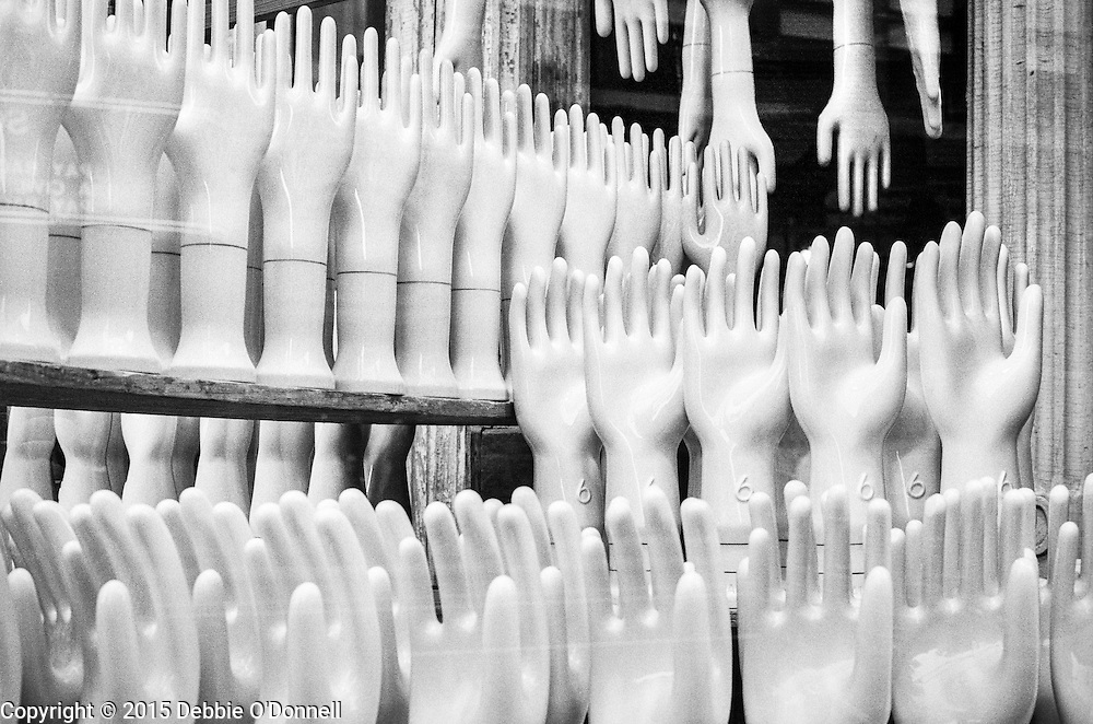 Porcelain hand-and-arm molds displayed in the window of Fishs Eddy located on the corner of Broadway and 19th street New York.