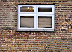 © Licensed to London News Pictures. 19/12/2011, London, UK. Windows at the North Korean embassy in West London are covered today with paper. Kim Jong Il's death on Saturday, aged 69, was announced last night in a special broadcast by state TV from the North Korean capital. Photo credit: Stephen Simpson/LNP