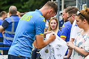 Leeds United forward Ryan Edmondson signs autographs during the Pre-Season Friendly match between Tadcaster Albion and Leeds United at i2i Stadium, Tadcaster, United Kingdom on 17 July 2019.