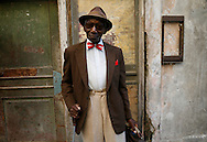 Retired musician Alberto pauses along Calle Obispo in Old Havana for photograph. He recently celebrated his 86th birthday this past February and is a regular around the tourist areas of the old city where he greets visitors and insists on being paid one peso for his photograph.