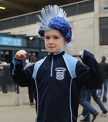 Westport supporter Cian Hughes with his special hair-do in honour of Westport.<br />Pic Conor McKeown