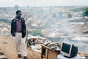 Man sells old electronical equipment in Kibera slum, Kenya
