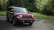 USA, Oregon, Willamette Mission State Park, Jeep Patriot driving in the park. MR, PR