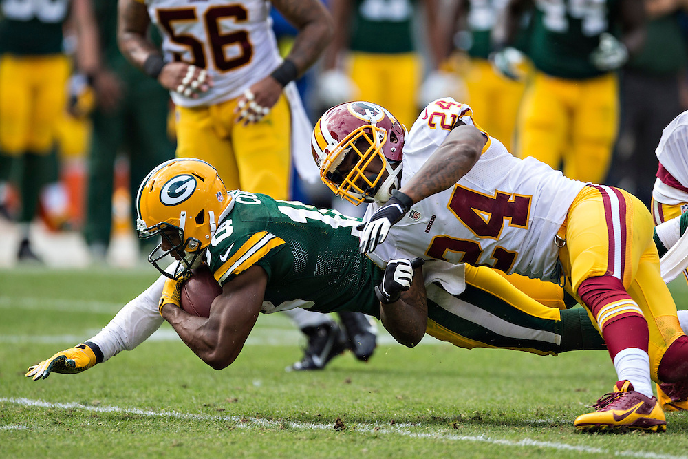 GREEN BAY, WI - SEPTEMBER 15:  Randall Cobb #18 of the Green Bay Packers is tackled by Bacarri Rambo #24 of the Washington Redskins at Lambeau Field on September 15, 2013 in Green Bay, Wisconsin. The Packers defeated the Redskins 38-20.  (Photo by Wesley Hitt/Getty Images) *** Local Caption *** Randall Cobb; Bacarri Rambo
