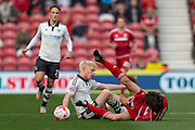 Middlesbrough FC striker Diego Fabbrini brought down by Fulham midfielder Ben Pringle  during the Sky Bet Championship match between Middlesbrough and Fulham at the Riverside Stadium, Middlesbrough, England on 17 October 2015. Photo by George Ledger.