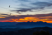 """Ravens flying by Montserrat, viewed from La Mola, a mountain in the park of Sant Llorenç del Munt i l'Obac - La Mola, Mountain, Barcelona, Catalonia, Spain This mage can be licensed via Millennium Images. Contact me for more details, or email mail@milim.com For prints, contact me, or click """"add to cart"""" to some standard print options."""