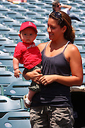 ANAHEIM, CA - MAY 14:  A mother holds her son, a young fan of the Los Angeles Angels of Anaheim before the game against the Boston Red Sox at Angel Stadium in Anaheim, California on Thursday, May 14, 2009.  The Angels defeated the Red Sox 5-4 in 12 innings.  (Photo by Paul Spinelli/MLB Photos)