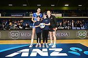 ANZ Future Captains Isla Clayton aged 9 and Emma Wilson aged 10 pose for a photo with Anna Harrison of the Mystics and Samantha Sinclair of the Magic prior to the match. 2018 ANZ Premiership netball match, Mystics v Magic at The Trusts Arena, Auckland, New Zealand. 25 July 2018 © Copyright Photo: Anthony Au-Yeung / www.photosport.nz