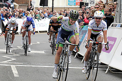 ©Licensed to London News Pictures. 07/05/2014<br /> Northampton, Northamptonshire. Emma Johansson riding for Orica AIS punches the air as beats Marianne Vos into second at the end of the race in Northampton.<br /> Photo credit: Steven Prouse/ LNP