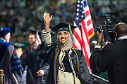 Zamam AL- Bulushi waves to supporters during undergraduate commencement ceremonies. Photo by Ben Siegel