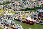 Nederland, Zuid-Holland, Rotterdam, 10-06-2015; Schiedam, WIltonhaven met Huisman equipment (bouw en installatie van kranen, pijpleginstallaties en boorsystemen voor offshore schepen). In de haven diverse schepen zoals gebruikt in de offshore (pijpenleg) industrie <br /> Wilton harbour, Huisman equipment, construction and installation of cranes, pipelay equipment and drilling systems for offshore vessels.<br /> <br /> luchtfoto (toeslag op standard tarieven);<br /> aerial photo (additional fee required);<br /> copyright foto/photo Siebe Swart