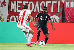 16.09.2015, Karaiskakis Stadium, Piräus, GRE, UEFA CL, Olympiakos Piräus vs FC Bayern München, Gruppe F, im Bild l-r: im Zweikampf, Aktion, mit Omar Elabdellaoui #14 (Olympiakos Piraeus) und Douglas Costa #11 (FC Bayern Muenchen) // during UEFA Champions League group F match between Olympiacos F.C. and FC Bayern Munich at the Karaiskakis Stadium in Piräus, Greece on 2015/09/16. EXPA Pictures © 2015, PhotoCredit: EXPA/ Eibner-Pressefoto/ Kolbert<br /> <br /> *****ATTENTION - OUT of GER*****