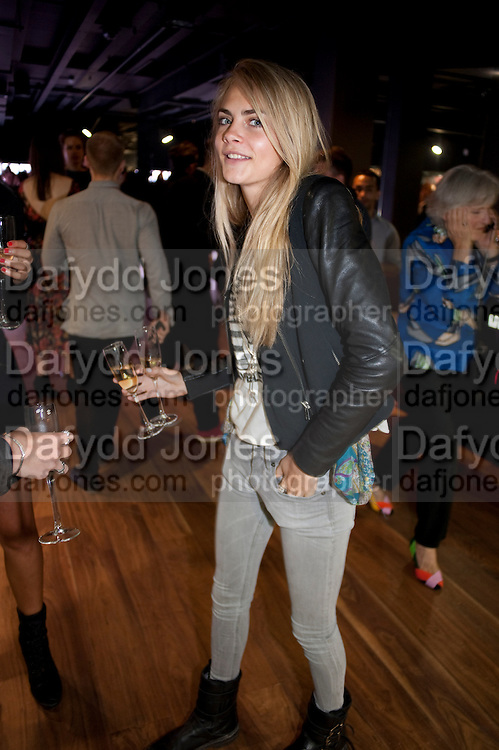 CARA DELEVIGNE, United Nude launched their London shop.  in association with TANK Magazine. Floral st. Covent Garden. London. 7 September 2011. <br /> <br />  , -DO NOT ARCHIVE-© Copyright Photograph by Dafydd Jones. 248 Clapham Rd. London SW9 0PZ. Tel 0207 820 0771. www.dafjones.com.