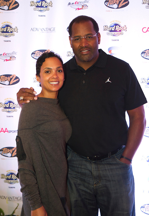 DeEtta Jones and NFL Hall of Famer Richard Dent on the red carpet for the kick off party for the 9th Annual Derek Jeter Celebrity Golf Classic presented by Seminole Hard Rock Hotel & Casino in Tampa..Photo by James Branaman