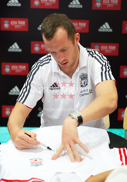 KUALA LUMPUR, MALAYSIA - Friday, July 15, 2011: Liverpool's new signing Charlie Adam during a promotional event at the Adidas store at the Mid Valley Shopping Centre on day five of the club's Asia Tour. (Photo by David Rawcliffe/Propaganda)
