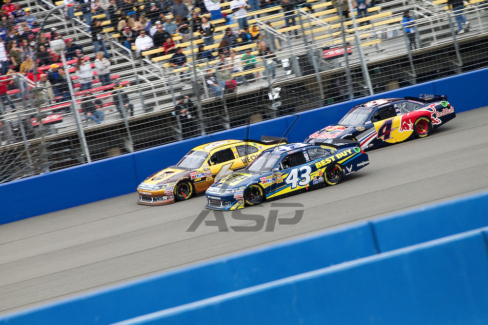 FONTANA, CA - MAR 27, 2011:  David Ragan (6), A.J. Allmendinger (43), and Kasey kahne (4) race for position down the front stretch during the Auto Club 400 race at the Auto Club Speedway in Fontana, CA.