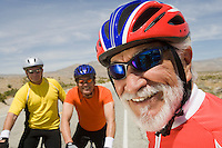 Senior men wearing cycling helmets