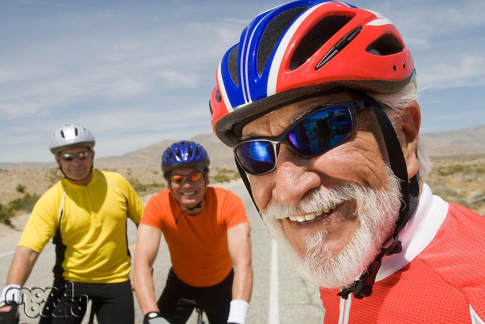 Senior men wearing cycling helmets