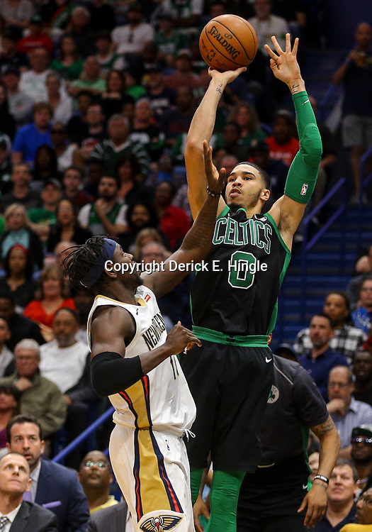Mar 18, 2018; New Orleans, LA, USA; Boston Celtics forward Jayson Tatum (0) shoots over New Orleans Pelicans guard Jrue Holiday (11) during the second half at the Smoothie King Center. The Pelicans defeated the Celtics 108-89. Mandatory Credit: Derick E. Hingle-USA TODAY Sports
