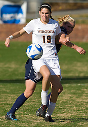 Virginia Cavaliers defender Alex Singer (19) in action against WVU.  The #16 ranked Virginia Cavaliers defeated the #12 ranked West Virginia Mountaineers 3-2 in the second round of NCAA Division 1 Women's Soccer Tournament at Klockner Stadium on the Grounds of the University of Virginia in Charlottesville, VA on November 16, 2008.