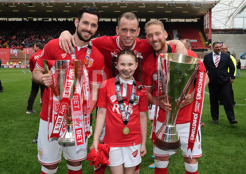Bristol City's Scott Wagstaff and Bristol City's Greg Cunningham lift the Sky Bet League One and JPT trophy's  with Bristol City's Aaron Wilbraham and his daughter - Photo mandatory by-line: Joe Meredith/JMP - Mobile: 07966 386802 - 03/05/2015 - SPORT - Football - Bristol - Ashton Gate - Bristol City v Walsall - Sky Bet League One