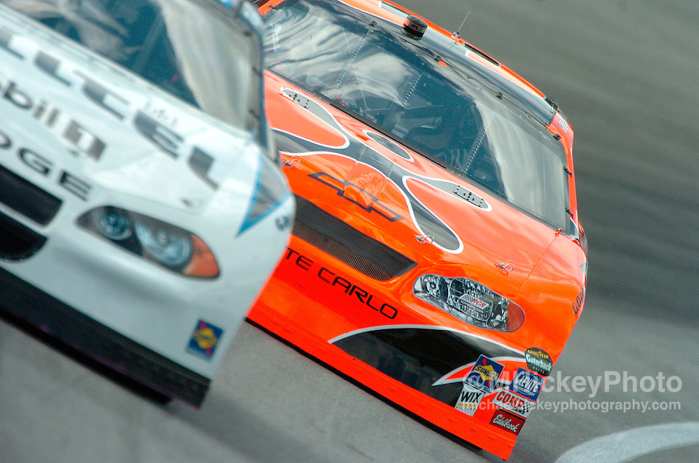 Robby Gordon comes up on Ryan Newman during practice for the Brickyard 400