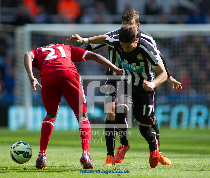 Ayoze Perez of Newcastle United challenges for the ball against Youssouf Mulumbu (L) of West Bromwich Albion during the Barclays Premier League match at St. James's Park, Newcastle<br /> Picture by Stephen Gaunt/Focus Images Ltd +447904 833202<br /> 09/05/2015
