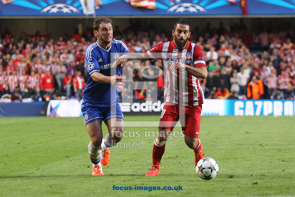 Branislav Ivanovic of Chelsea and Arda Turan of Athletico Madrid in action during the UEFA Champions League semi final second leg at Stamford Bridge, London<br /> Picture by Paul Chesterton/Focus Images Ltd +44 7904 640267<br /> 30/04/2014