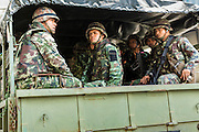 25 MAY 2014 - BANGKOK, THAILAND:  Thai soldiers in a truck in Bangkok. They were enroute a demonstration against the coup. Public opposition to the military coup in Thailand grew Sunday with thousands of protestors gathering at locations throughout Bangkok to call for a return of civilian rule and end to the military junta.    PHOTO BY JACK KURTZ