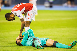 Theo Walcott #14 of Arsenal F.C. and Eduardo Carvalho #24 of GNK Dinamo Zagreb during football match between GNK Dinamo Zagreb, CRO and Arsenal FC, ENG in Group F of Group Stage of UEFA Champions League 2015/16, on September 16, 2015 in Stadium Maksimir, Zagreb, Croatia. Photo by Ziga Zupan / Sportida