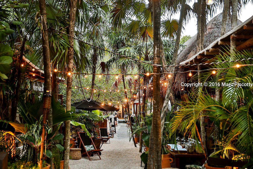 SHOT 12/8/16 4:58:14 PM - A set of boutique shops and a restaurant on the jungle road in Tulum, Mexico. The area has exploded with high end shops and restaurants catering to tourists in a jungle setting. Tulum is located in the Mayan Riviera and along the east coast of the Yucatán Peninsula on the Caribbean Sea in the state of Quintana Roo, Mexico. (Photo by Marc Piscotty / © 2016)
