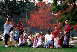 Stock photo of school children in the park with teachers