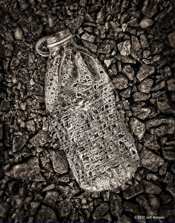Still life of a Plastic bottle found on a gravel road in the Wasatch Mountains in Utah.