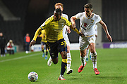 Coventry City forward Gervane Kastaneer (33) battles for possession  with Milton Keynes Dons midfielder Jordan Houghton (24) during the EFL Trophy match between Milton Keynes Dons and Coventry City at Stadium:MK, Milton Keynes, England on 3 December 2019.