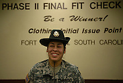U.S. Army Sergeant First Class Maria Herrera stands next to the wall where trainees get their final uniform fittings at Fort Jackson, S.C., on October 23, 2008.