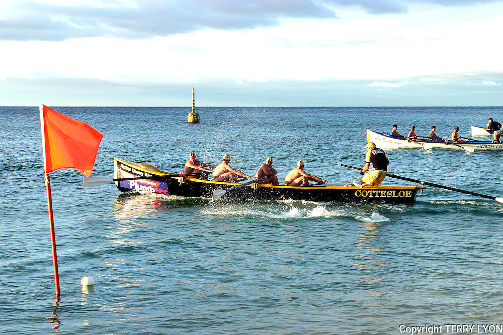 An inter club surf boat sprint race at Cottesloe Beach.